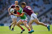 25 July 2021; Ryan O'Donoghue of Mayo in action against Paul Conroy of Galway during the Connacht GAA Senior Football Championship Final match between Galway and Mayo at Croke Park in Dublin. Photo by Ray McManus/Sportsfile