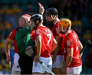 23 July 2021; Referee John Keenan shows a red card to Niall O'Leary of Cork, right, during the GAA Hurling All-Ireland Senior Championship Round 2 match between Clare and Cork at LIT Gaelic Grounds in Limerick. Photo by Piaras Ó Mídheach/Sportsfile