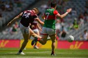 25 July 2021; Shane Walsh of Galway shoots to score his side's first goal despite the attention of Stephen Coen of Mayo during the Connacht GAA Senior Football Championship Final match between Galway and Mayo at Croke Park in Dublin. Photo by Harry Murphy/Sportsfile