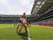 25 July 2021; Johnny Heaney of Galway keeps the ball in play under pressure from Bryan Walsh of Mayo during the Connacht GAA Senior Football Championship Final match between Galway and Mayo at Croke Park in Dublin. Photo by Ray McManus/Sportsfile
