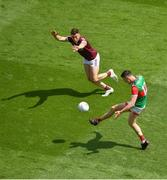 25 July 2021; Diarmuid O'Connor of Mayo in action against Shane Walsh of Galway during the Connacht GAA Senior Football Championship Final match between Galway and Mayo at Croke Park in Dublin. Photo by Daire Brennan/Sportsfile