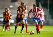 25 July 2021; Daniel Kelly of Dundalk in action against Anthony O'Donnell of Treaty United during the FAI Cup First Round match between Treaty United and Dundalk at Market's Field in Limerick. Photo by Diarmuid Greene/Sportsfile