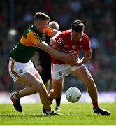 25 July 2021; Daniel Dineen of Cork is tackled by Jason Foley of Kerry during the Munster GAA Football Senior Championship Final match between Kerry and Cork at Fitzgerald Stadium in Killarney, Kerry. Photo by Eóin Noonan/Sportsfile