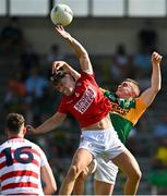 25 July 2021; Seán O'Shea of Kerry scores his side's third goal despite the efforts of Kevin O'Donovan of Cork during the Munster GAA Football Senior Championship Final match between Kerry and Cork at Fitzgerald Stadium in Killarney, Kerry. Photo by Eóin Noonan/Sportsfile