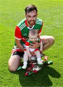 25 July 2021; Kevin McLoughlin of Mayo and his nine month old daughter Saorla with the Nestor Cup after Connacht GAA Senior Football Championship Final match between Galway and Mayo at Croke Park in Dublin. Photo by Ray McManus/Sportsfile
