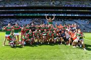 25 July 2021; The Mayo squad celebrate with the Nestor Cup after the Connacht GAA Senior Football Championship Final match between Galway and Mayo at Croke Park in Dublin. Photo by Ray McManus/Sportsfile