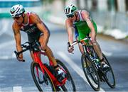 26 July 2021; Russell White of Ireland, right, in action during the cycling stage of the Men's Triathlon at the Odaiba Marine Park during the 2020 Tokyo Summer Olympic Games in Tokyo, Japan. Photo by Ramsey Cardy/Sportsfile