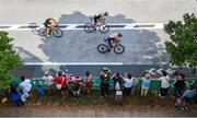 26 July 2021; Triathletes pass spectators during the cycling discipline of the men's triathlon at the Odaiba Marine Park during the 2020 Tokyo Summer Olympic Games in Tokyo, Japan. Photo by Ramsey Cardy/Sportsfile