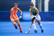 26 July 2021; Roisin Upton of Ireland in action against Lidewij Marsia Maria Weltenv during the women's pool A group stage match between Ireland and Netherlands at the Oi Hockey Stadium during the 2020 Tokyo Summer Olympic Games in Tokyo, Japan. Photo by Stephen McCarthy/Sportsfile