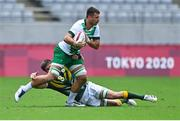 26 July 2021; Harry McNulty of Ireland is tackled by Impi Visser of South Africa during the rugby sevens men's pool C match between Ireland and South Africa at the Tokyo Stadium during the 2020 Tokyo Summer Olympic Games in Tokyo, Japan. Photo by Brendan Moran/Sportsfile
