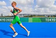 26 July 2021; Russell White of Ireland during the men's triathlon at the Odaiba Marine Park during the 2020 Tokyo Summer Olympic Games in Tokyo, Japan. Photo by Ramsey Cardy/Sportsfile