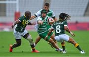 26 July 2021; Foster Horan of Ireland is tackled by Siviwe Soyizwapi, left, and Selvyn Davids of South Africa during the rugby sevens men's pool C match between Ireland and South Africa at the Tokyo Stadium during the 2020 Tokyo Summer Olympic Games in Tokyo, Japan. Photo by Brendan Moran/Sportsfile