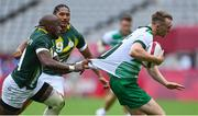 26 July 2021; Terry Kennedy of Ireland is tackled by of Siviwe Soyizwapi of South Africa during the rugby sevens men's pool C match between Ireland and South Africa at the Tokyo Stadium during the 2020 Tokyo Summer Olympic Games in Tokyo, Japan. Photo by Brendan Moran/Sportsfile