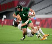 26 July 2021; Foster Horan of Ireland is tackled by Steve Tomasin of United States during the rugby sevens men's pool C match between Ireland and USA at the Tokyo Stadium during the 2020 Tokyo Summer Olympic Games in Tokyo, Japan. Photo by Stephen McCarthy/Sportsfile