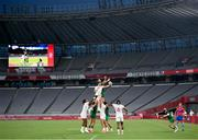 26 July 2021; Matt Thompson of United States in action against Foster Horan of Ireland during the rugby sevens men's pool C match between Ireland and USA at the Tokyo Stadium during the 2020 Tokyo Summer Olympic Games in Tokyo, Japan. Photo by Stephen McCarthy/Sportsfile
