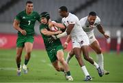 26 July 2021; Foster Horan of Ireland is tackled by Perry Baker of United States during the rugby sevens men's pool C match between Ireland and USA at the Tokyo Stadium during the 2020 Tokyo Summer Olympic Games in Tokyo, Japan. Photo by Stephen McCarthy/Sportsfile