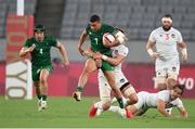 26 July 2021; Jordan Conroy of Ireland is tackled by Joe Schroeder of United States during the rugby sevens men's pool C match between Ireland and USA at the Tokyo Stadium during the 2020 Tokyo Summer Olympic Games in Tokyo, Japan. Photo by Stephen McCarthy/Sportsfile
