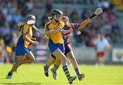 20 July 2013; Eimear Considine, Clare, in action against Fiona Kavanagh, Wexford. Liberty Insurance Senior Camogie Championship, Group 1, Wexford v Clare, Wexford Park, Wexford. Picture credit: David Maher / SPORTSFILE