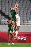 26 July 2021; Terry Kennedy with the support of his Ireland team-mate Jordan Conroy in action against Maceo Brown of United States during the rugby sevens men's pool C match between Ireland and USA at the Tokyo Stadium during the 2020 Tokyo Summer Olympic Games in Tokyo, Japan. Photo by Stephen McCarthy/Sportsfile