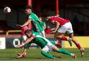 25 July 2021; Jordan Gibson of Sligo Rovers in action against Steven Beattie and Joshua Honohan of Cork City during the FAI Cup First Round match between Sligo Rovers and Cork City at The Showgrounds in Sligo. Photo by Michael P Ryan/Sportsfile