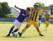 24 July 2021; Dan Hawkins of Finn Harps in action against AJ O'Conor of Fairview Rangers  during the FAI Cup First Round match between Fairview Rangers and Finn Harps at Fairview Rangers AFC in Limerick. Photo by Michael P Ryan/Sportsfile
