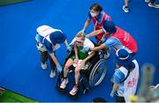 27 July 2021; Carolyn Hayes of Ireland is treated by medical personnel after finishing the Women's Triathlon at the Odaiba Marine Park during the 2020 Tokyo Summer Olympic Games in Tokyo, Japan. Photo by Stephen McCarthy/Sportsfile