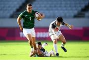 27 July 2021; Jordan Conroy of Ireland in action against Wanyong Park, left, and Yeon Sik Jeong of Republic of Korea during the Men's Rugby Sevens 9th place play-off match between Ireland and Republic of Korea at the Tokyo Stadium during the 2020 Tokyo Summer Olympic Games in Tokyo, Japan. Photo by Stephen McCarthy/Sportsfile