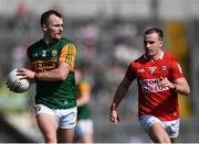 25 July 2021; Tom O'Sullivan of Kerry in action against Mattie Taylor of Cork during the Munster GAA Football Senior Championship Final match between Kerry and Cork at Fitzgerald Stadium in Killarney, Kerry. Photo by Piaras Ó Mídheach/Sportsfile