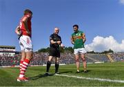 25 July 2021; Referee Barry Cassidy performs the coin toss with team captains Ian Maguire of Cork and Paul Murphy of Kerry before the Munster GAA Football Senior Championship Final match between Kerry and Cork at Fitzgerald Stadium in Killarney, Kerry. Photo by Piaras Ó Mídheach/Sportsfile