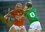 27 July 2021; Ben Nyhan of Cork in action against Cian O'Carroll of Limerick during the Electric Ireland Munster GAA Minor Hurling Championship Semi-Final match between Limerick and Cork at Semple Stadium in Thurles, Tipperary. Photo by Eóin Noonan/Sportsfile