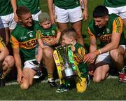 25 July 2021; Kerry footballer Gavin Crowley, 6, with his son Arlo and Paul Geaney with his son Paidi, as they celebrate with the cup after the Munster GAA Football Senior Championship Final match between Kerry and Cork at Fitzgerald Stadium in Killarney, Kerry. Photo by Piaras Ó Mídheach/Sportsfile