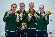 28 July 2021; Ireland rowers, from left, Aifric Keogh, Eimear Lambe, Fiona Murtagh and Emily Hegarty celebrate on the podium with their bronze medals after finishing 3rd place in the Women's Four final at the Sea Forest Waterway during the 2020 Tokyo Summer Olympic Games in Tokyo, Japan. Photo by Seb Daly/Sportsfile