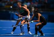 28 July 2021; Deirdre Duke of Ireland in action against Jette Fleschütz of Germany during the women's pool A group stage match between Germany and Ireland at the Oi Hockey Stadium during the 2020 Tokyo Summer Olympic Games in Tokyo, Japan. Photo by Brendan Moran/Sportsfile