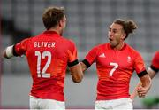 27 July 2021; Dan Bibby and Harry Glover, left, of Great Britain celebrate following the Men's Rugby Sevens quarter-final match between Great Britain and United States at the Tokyo Stadium during the 2020 Tokyo Summer Olympic Games in Tokyo, Japan. Photo by Stephen McCarthy/Sportsfile