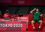 28 July 2021; Nhat Nyugen of Ireland takes a water break during the men's singles group play stage match against Tzu-Wei Wang of Chinese Taipei  at the Musashino Forest Sport Plaza during the 2020 Tokyo Summer Olympic Games in Tokyo, Japan. Photo by Brendan Moran/Sportsfile