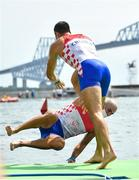 29 July 2021; Martin Sinkovic of Croatia is thrown into the water by his brother and team-mate Valent Sinkovic as they celebrate winning the Men's Pair final A at the Sea Forest Waterway during the 2020 Tokyo Summer Olympic Games in Tokyo, Japan. Photo by Seb Daly/Sportsfile