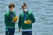 29 July 2021; Fintan McCarthy, left, and Paul O'Donovan of Ireland celebrate after with their gold medals after winning the Men's Lightweight Double Sculls final at the Sea Forest Waterway during the 2020 Tokyo Summer Olympic Games in Tokyo, Japan. Photo by Brendan Moran/Sportsfile