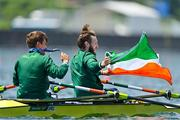 29 July 2021; Fintan McCarthy, left, and Paul O'Donovan of Ireland celebrate with their gold medals and the Irish flag after winning the Men's Lightweight Double Sculls final at the Sea Forest Waterway during the 2020 Tokyo Summer Olympic Games in Tokyo, Japan. Photo by Brendan Moran/Sportsfile