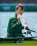 29 July 2021; Fintan McCarthy of Ireland celebrates with his gold medal after winning the Men's Lightweight Double Sculls final with team-mate  Paul O'Donovan at the Sea Forest Waterway during the 2020 Tokyo Summer Olympic Games in Tokyo, Japan. Photo by Seb Daly/Sportsfile