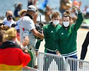 29 July 2021; Fintan McCarthy, left, and Paul O'Donovan of Ireland wave to the crowd as they make their way to the podium after winning the Men's Lightweight Double Sculls final at the Sea Forest Waterway during the 2020 Tokyo Summer Olympic Games in Tokyo, Japan. Photo by Seb Daly/Sportsfile
