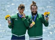 29 July 2021; Fintan McCarthy, left, and Paul O'Donovan of Ireland celebrate with their gold medals after winning the Men's Lightweight Double Sculls final at the Sea Forest Waterway during the 2020 Tokyo Summer Olympic Games in Tokyo, Japan. Photo by Seb Daly/Sportsfile
