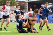 28 July 2021; Patrick Dooley of Midlands is tackled by Sean Lavin, left, and Max Gaynor of North Midlands during the Shane Horgan Cup Round 1 match between Midlands and North Midlands at Energia Park in Dublin. Photo by Sam Barnes/Sportsfile