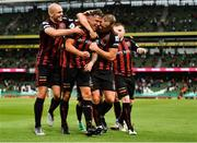 29 July 2021; Rob Cornwall of Bohemians celebrates with team-mates Georgie Kelly, left, and Ciarán Kelly, right after scoring his side's first during the UEFA Europa Conference League second qualifying round second leg match between Bohemians and F91 Dudelange at Aviva Stadium in Dublin. Photo by Eóin Noonan/Sportsfile