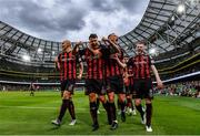 29 July 2021; Rob Cornwall of Bohemians, centre, celebrates with team-mates, from left, Georgie Kelly, Ciarán Kelly and Ross Tierney after scoing his side's first goal during the UEFA Europa Conference League second qualifying round second leg match between Bohemians and F91 Dudelange at Aviva Stadium in Dublin. Photo by Eóin Noonan/Sportsfile