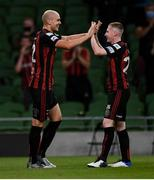 29 July 2021; Georgie Kelly of Bohemians is congratulated by team-mate Ross Tierney, right, after scoring his side's second goal during the UEFA Europa Conference League second qualifying round second leg match between Bohemians and F91 Dudelange at the Aviva Stadium in Dublin. Photo by Ben McShane/Sportsfile