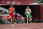 30 July 2021; Cillin Greene of Ireland and Samuel Garcia of Spain in action during the 4x400 metre mixed relay at the Olympic Stadium during the 2020 Tokyo Summer Olympic Games in Tokyo, Japan. Photo by Ramsey Cardy/Sportsfile