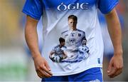 30 July 2021; A Monaghan player wears a shirt in honour of the late Brendan Óg Duffy, captain of the Monaghan U20 football team who passed away recently, in the warm-up before the EirGrid Ulster GAA Football U20 Championship Final match between Down and Monaghan at Athletic Grounds in Armagh. Photo by Piaras Ó Mídheach/Sportsfile