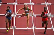 31 July 2021; Sarah Lavin of Ireland, centre, in action during the qualifying round of the women's 100 metres hurdles at the Olympic Stadium during the 2020 Tokyo Summer Olympic Games in Tokyo, Japan. Photo by Brendan Moran/Sportsfile