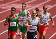 31 July 2021; Mark English of Ireland, second left, crosses the finish line during round one of the men's 800 metres heats at the Olympic Stadium during the 2020 Tokyo Summer Olympic Games in Tokyo, Japan. Photo by Brendan Moran/Sportsfile