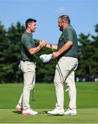 31 July 2021; Rory McIlroy, left, and Shane Lowry of Ireland exchange a handshake on the 18th green after completing round 3 of the men's individual stroke play at the Kasumigaseki Country Club during the 2020 Tokyo Summer Olympic Games in Kawagoe, Saitama, Japan. Photo by Ramsey Cardy/Sportsfile